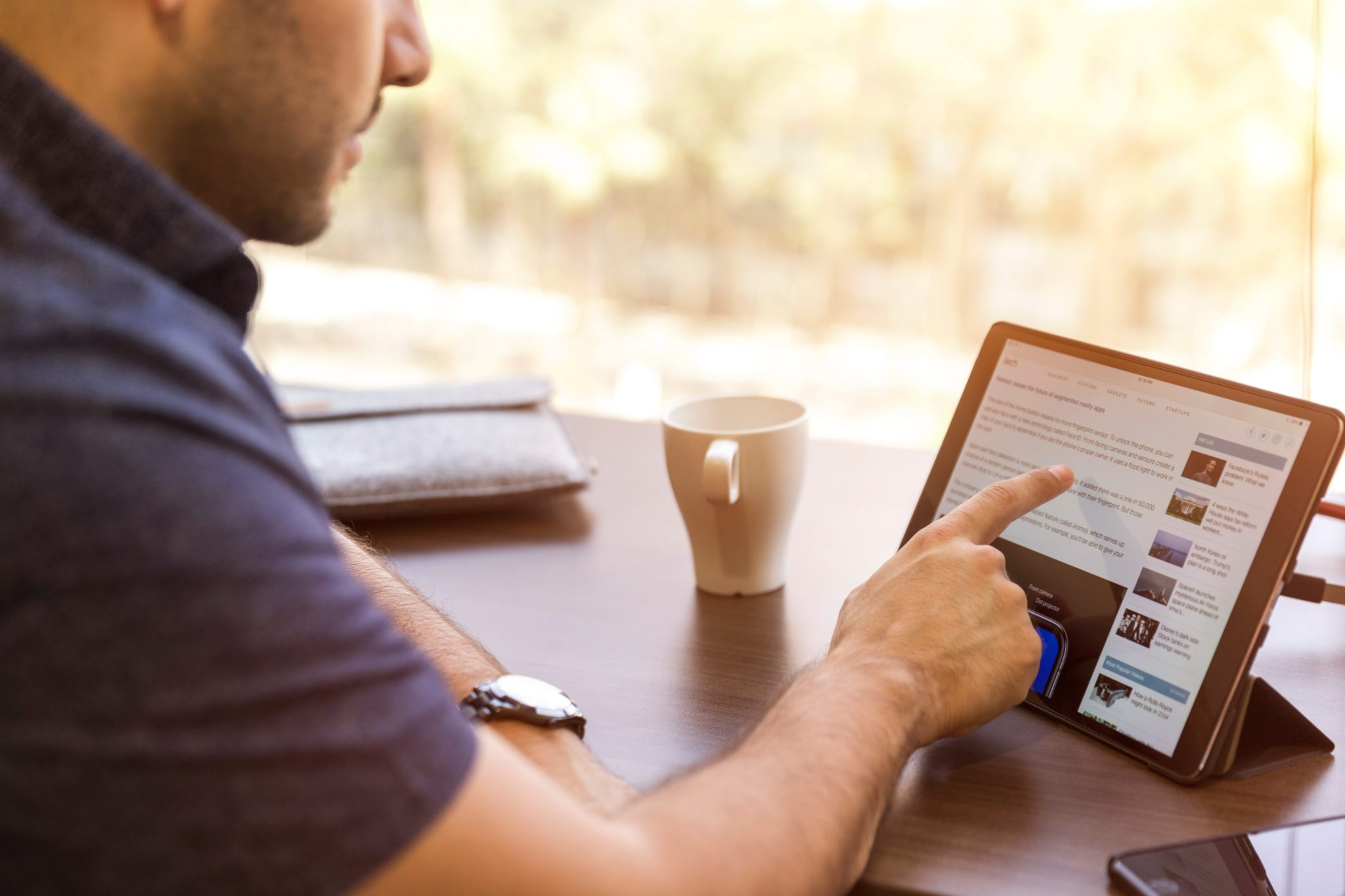 Man Scrolling the LinkedIn at Small Business