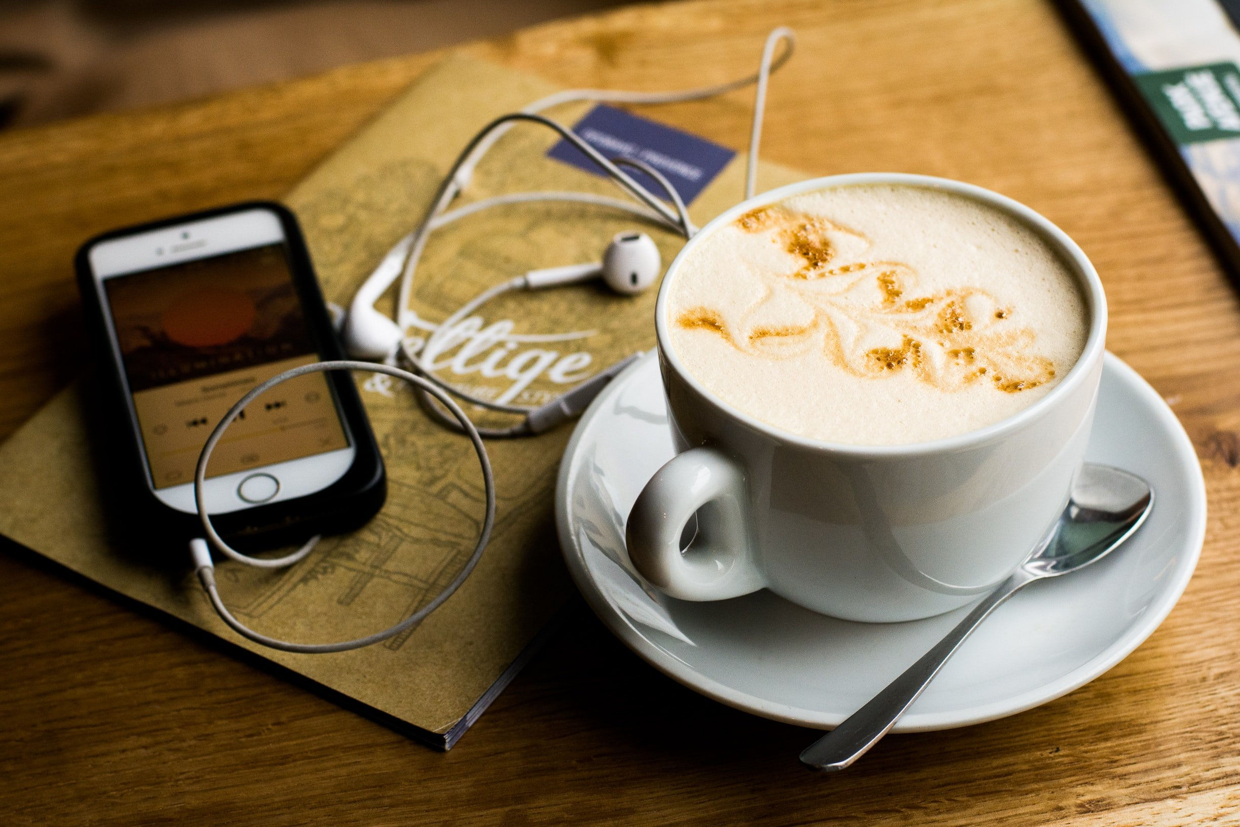 Listening to Small Business Podcasts at Coffee Shop